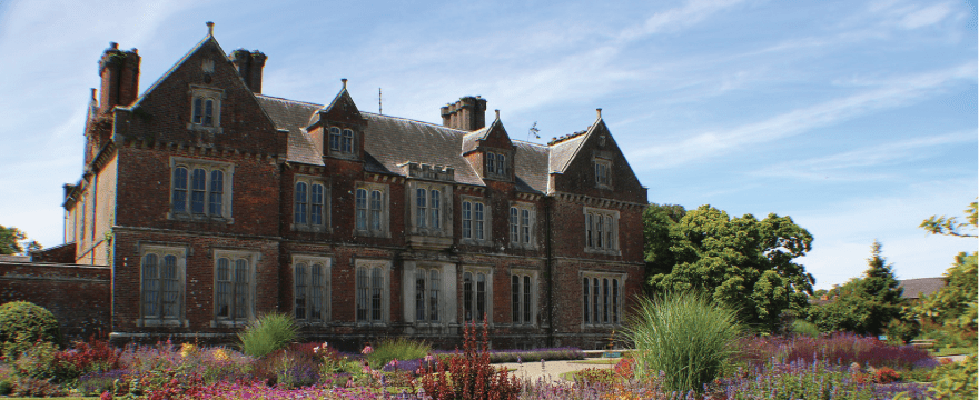Wells House with all the trees and flowers surrounding