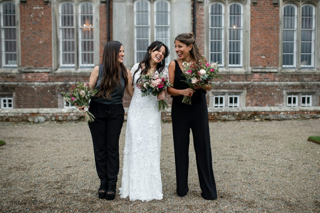 2 females and the bride laughing together
