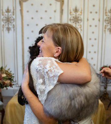 Bride giving her mother a hug