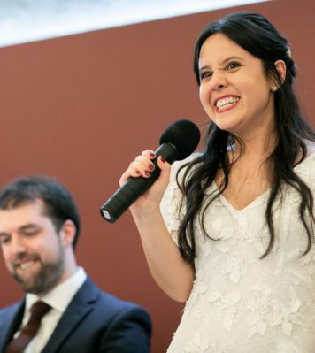 Bride holding a mic and giving a speech