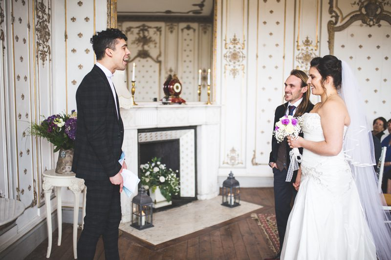 Bride and groom standing at the altar with the best man