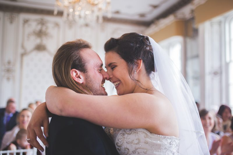 Bride and groom holding each other and smiling