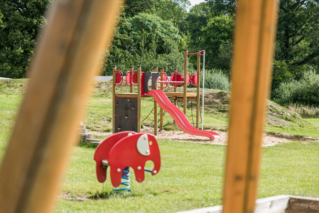 Outdoor playground set with slide, jungle gym, stairs and bridge